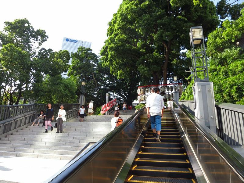 Up the escalator to Hie-Jinja Shrine. Aliza took the steps.