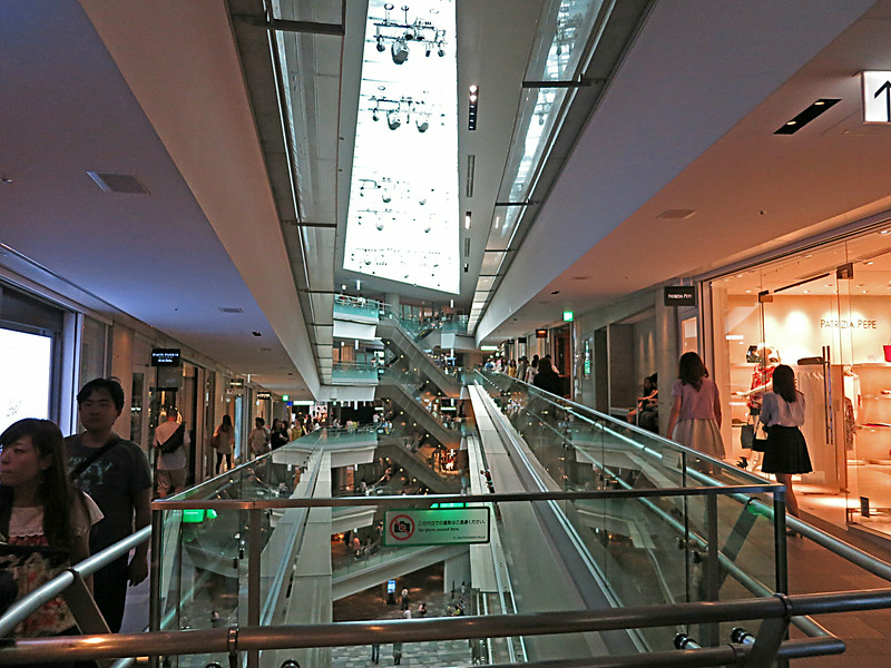 The  triangular atrium of the Omotesando Hills shopping mall