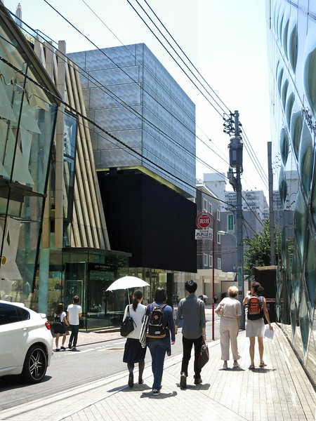 Next to Cartier, across from Prada (right edge of photo), is Marc Jacobs, by Stephen Jaklitsch. There's nothing behind the panels above the black box of the store, which glow like a giant lantern at night.
