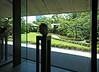 In the Nezu Museum lobby, looking out at garden and city