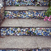 6/15 - The Little Chapel is decorated with seashells, pebbles and colorful pieces of broken china. Even the steps leading to the Chapel had them.