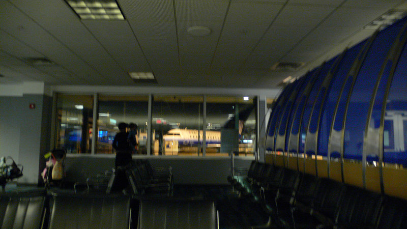 DC airport... Early morning...<br /> <br /> A mother telling here child. We are going on that plane...