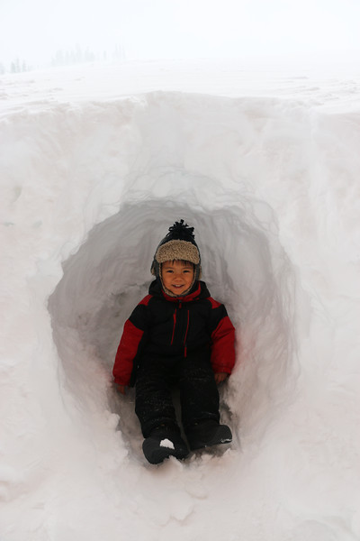Ryan found a lovely hole in the huge wall of snow while saying bye to his big brothers as they left to ski