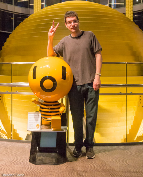 Alan and the Damper Baby - Taipei 101's mascot.<br /> Behind him is a massive tuned mass damper - designed to protect the building from winds during typhoons.