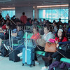 Passengers waiting to board an airplane at the airport terminal in Taipei, Taiwan.