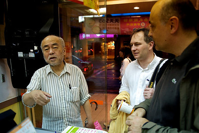 Old man giving help ordering in a small restaurant, Taipei.