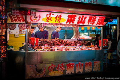 duck head shop at night market (high tech with queue number and waiting time displayed)