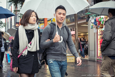 fashion couple in the rain
