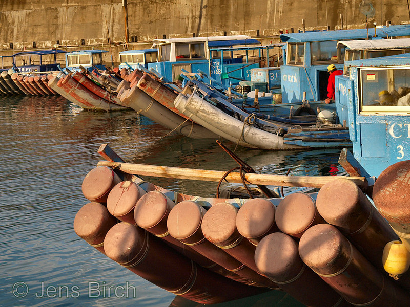 Raft-like boats at a Pacific ocean fishing harbour in the Kenting national park.