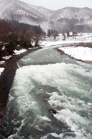 Spring Melt flows  into the Shokawa River, Shirakawa, Japan