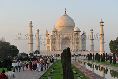 Taj Mahal, Agra, India. While the white domed marble mausoleum is its most familiar component, the Taj Mahal is actually an integrated complex of structures. Building began around 1632 and was completed around 1653, and employed thousands of artisans and craftsmen. The marble dome that surmounts the tomb is the most spectacular feature. Because of its shape, the dome is often called an onion dome or amrud (guava dome).