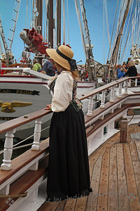 Looking Overboard ~ As part of the Tall Ships Festival, many people were dressed in period costumes.  I liked the look of this young woman at the ship's rail, as if looking out to sea.