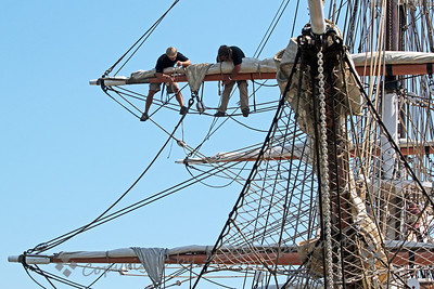 Crew in the Rigging ~ High in the rigging on this ship, two crew members prepare the sails.