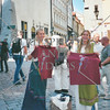 Local girls display shirts for sale in the town of Tallinn, Estonia.