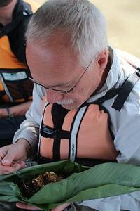 Delicious fried rice lunch on the boat served in a banana leaf packet.