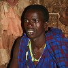 Eric, chief of the Masai boma we visited and our guide inside a house. (photo courtesy of Jim Furner)