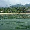 Our floating-in-the-lake view of Nkungwe camp, over the clear Lake Tanganyika water, turned green after a storm