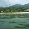 Nkungwe From the Lake: Our floating-in-the-lake view of Nkungwe camp, over the clear Lake Tanganyika water, turned green after a storm