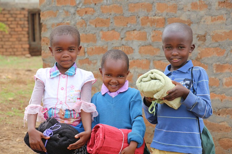 Students with school and personal care kits. Photo by Brenda Kimaro