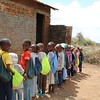 Students with school kits. Photo by Brenda Kimaro