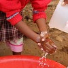 Students using soap from personal care kits. Photo by Brenda Kimaro