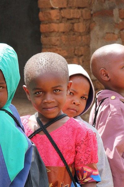 Students with school kit. Photo by Brenda Kimaro