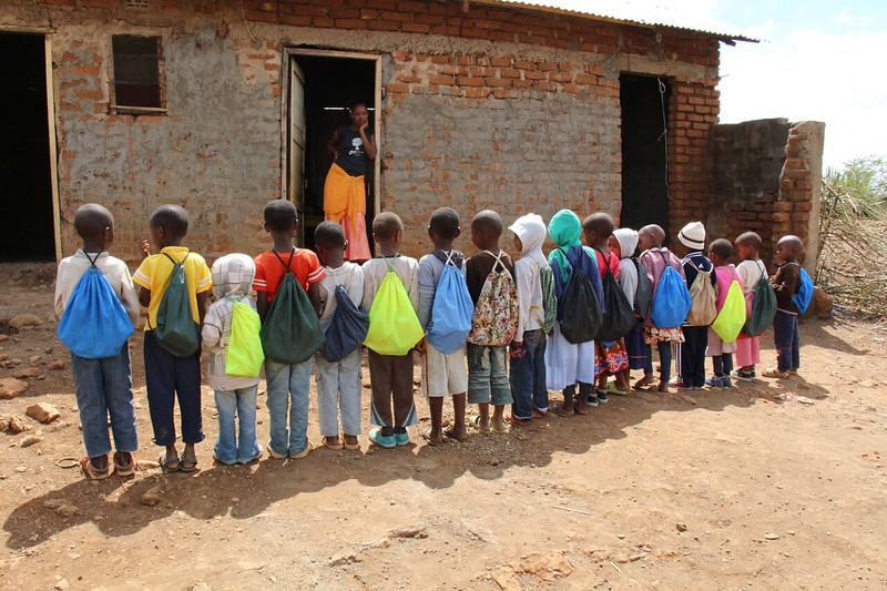 Students with school kits. Photo by Brenda Kimaro