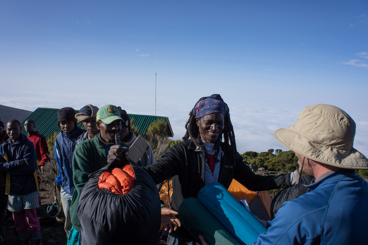 Trish and John gave sleeping bags to Kapanya.