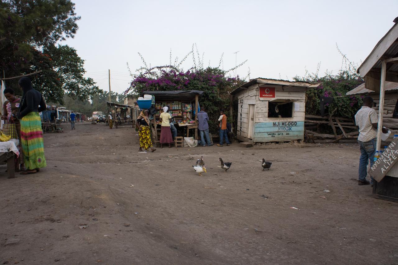 People selling wares in the street.