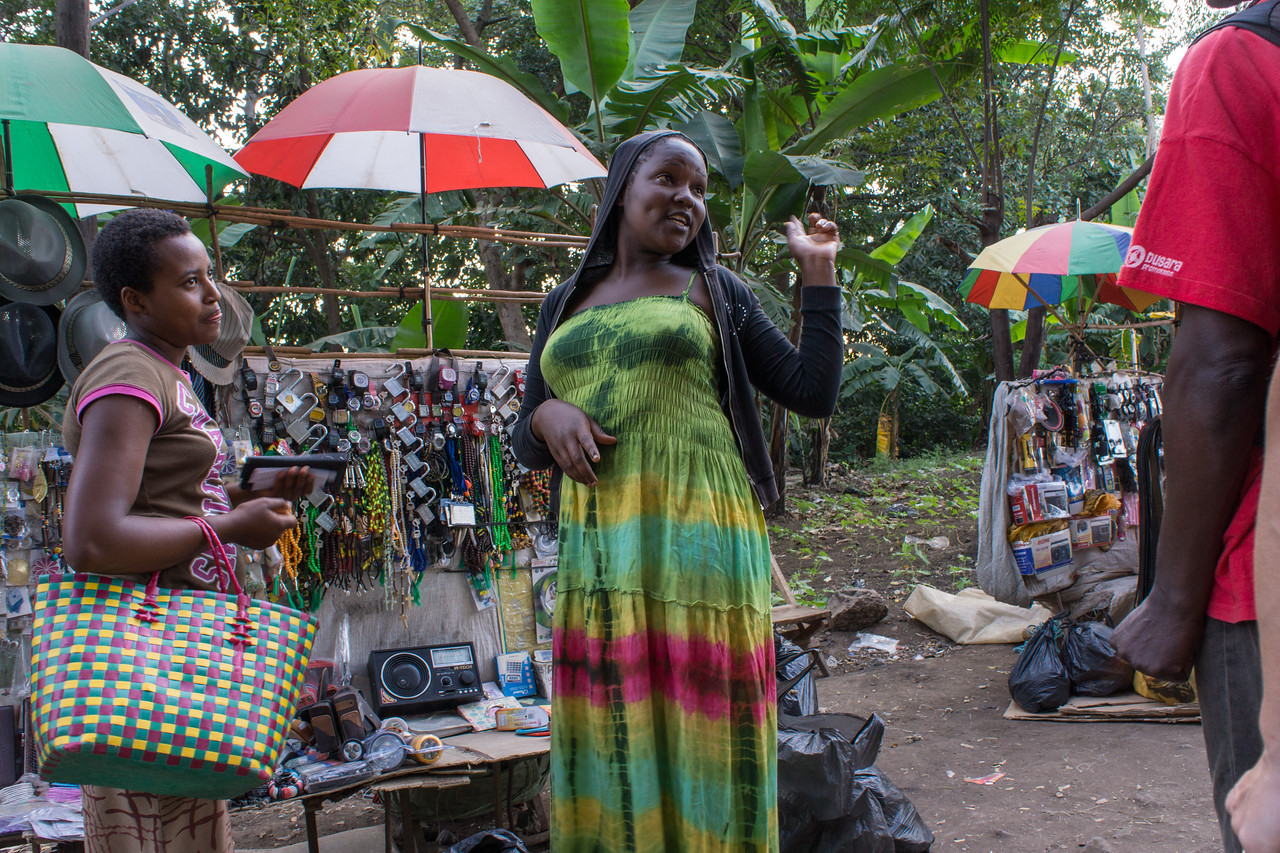 A woman talks to Kapanya in the market.