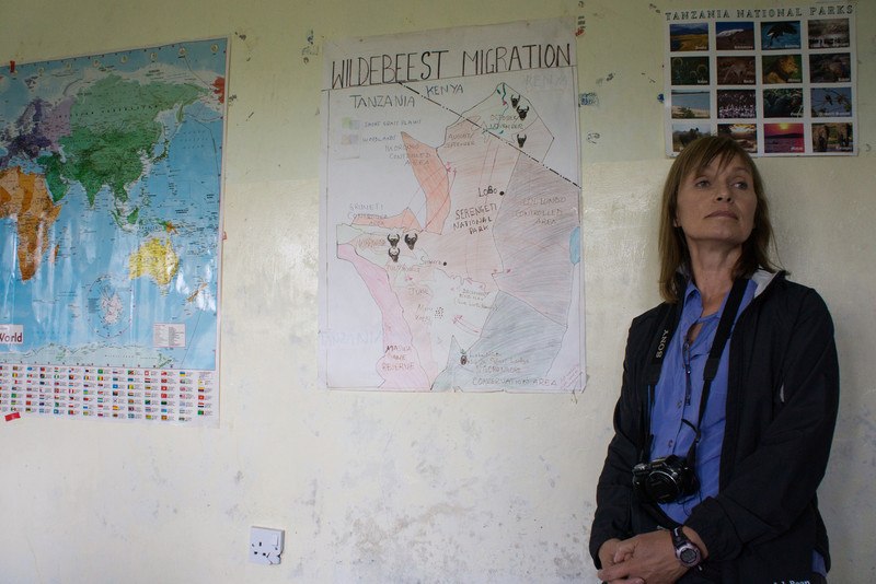 Inside Kapanya's classroom. Cindy poses with the maps.