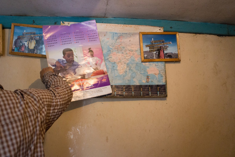Photos of Nema on Kilimanjaro are on the wall.
