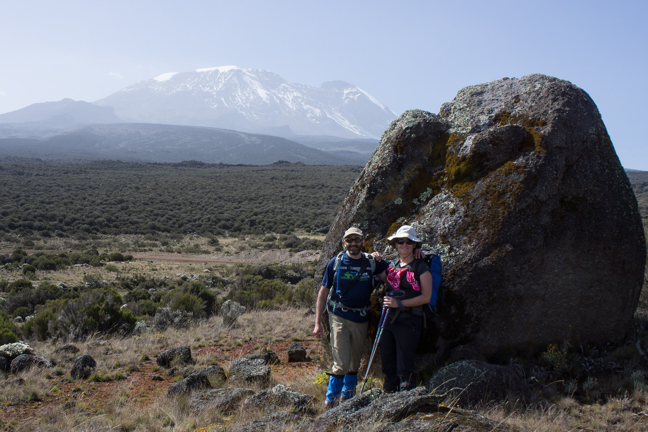 Lisa and I pose near a large boulder with Kibo in the background.