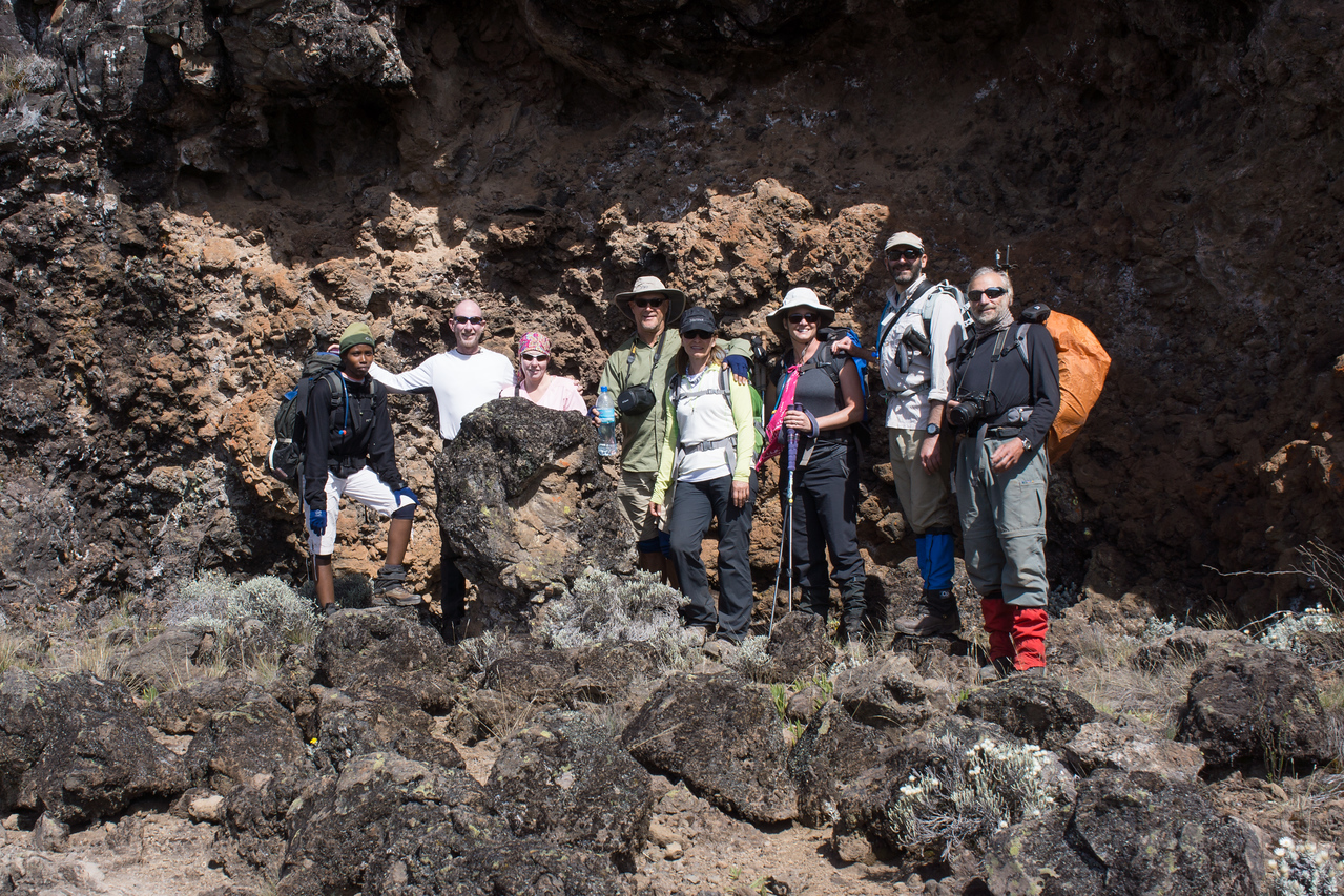 The group near a cave in the lava flow.