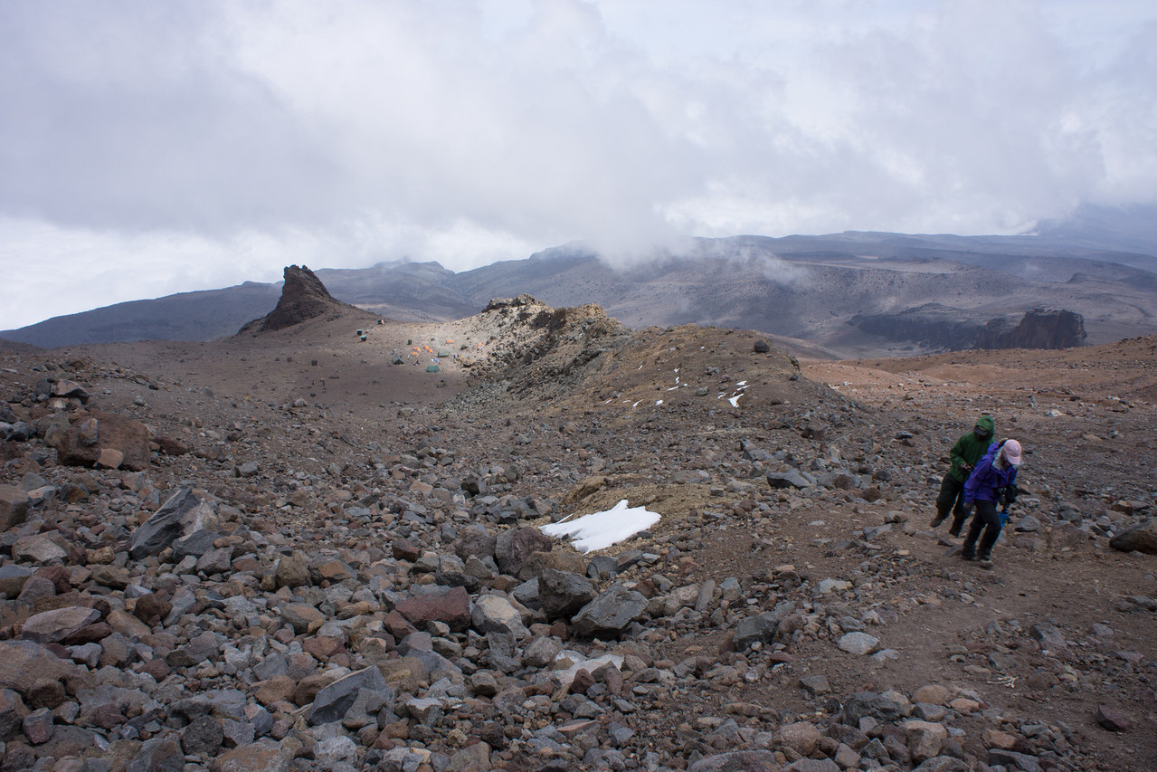 Packs off, we start an acclimatization hike on the Western Breach above camp. You can see camp below.