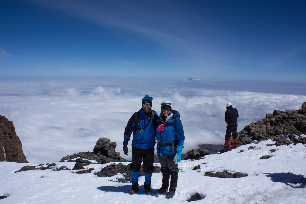 Posing at the rim of the Breach. Mt. Meru behind (and below) us.