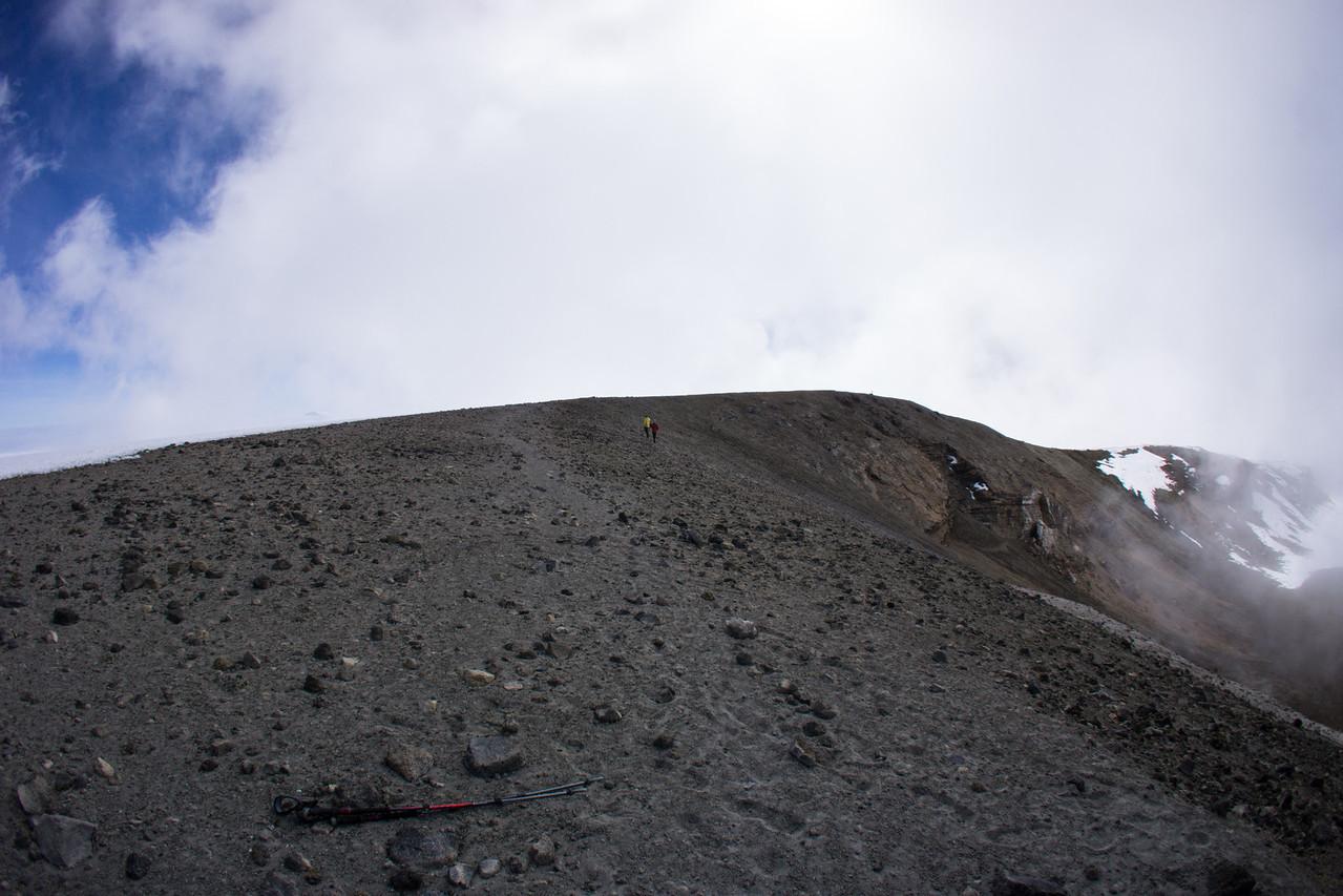 John and Kapanya walking along the rim of the ash pit.