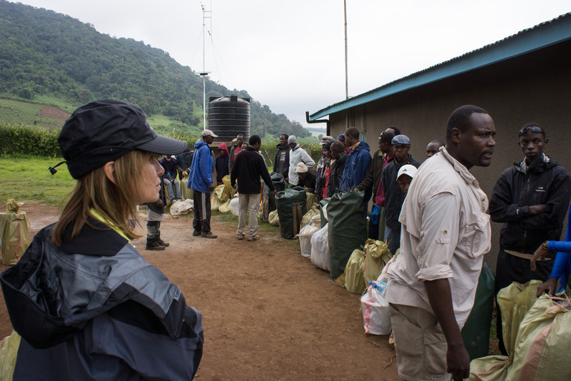 Our porters lined up to weigh their packs. Manasa (our cook) is giving orders while Cindy watches.