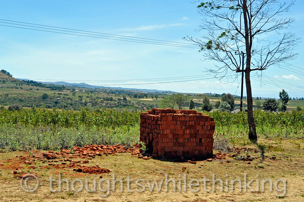 By building a fire in the space within the surrounding walls of bricks, they are hardened and made ready for construction.