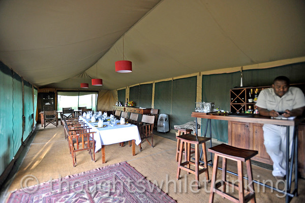 silver service, crystal and fine table settings for dinner at Lemala Ngorongoro Camp