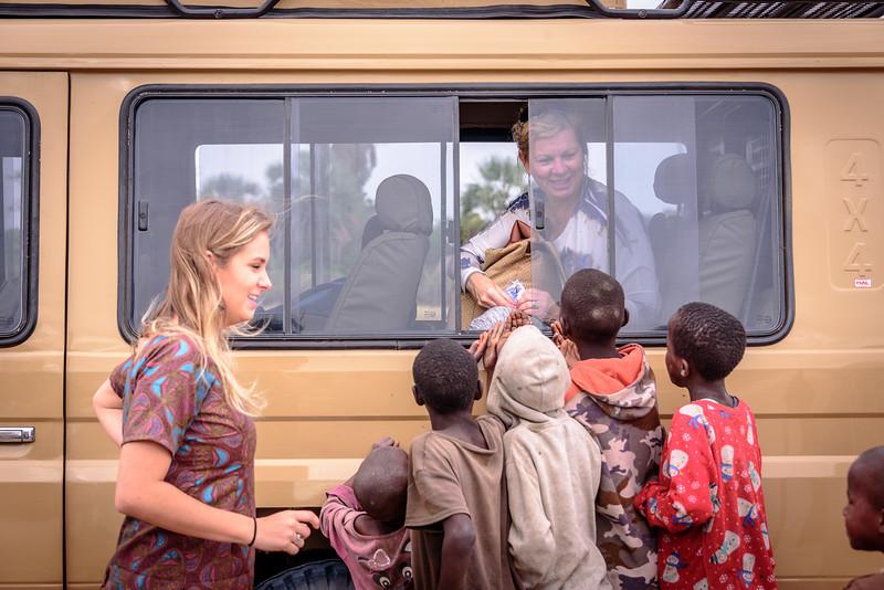 Kendall and Bridget greet the village children