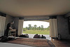 Sliding glass doors open to the Serengeti savanna, no one or other tents in sight.