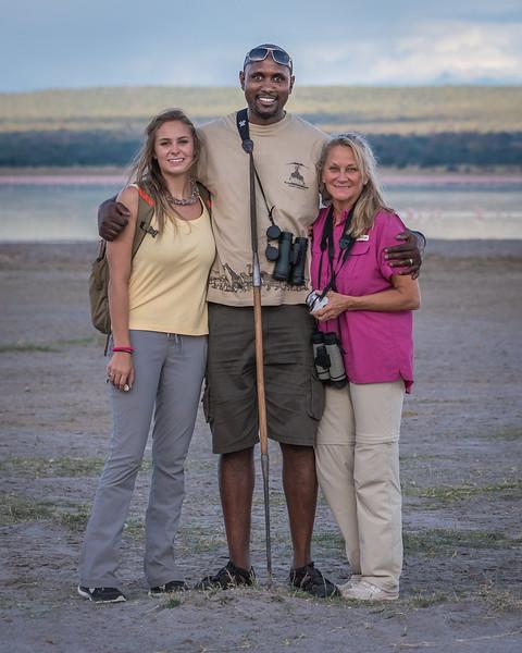 Kendall, Samson and Laura on the shore of lake Burungi