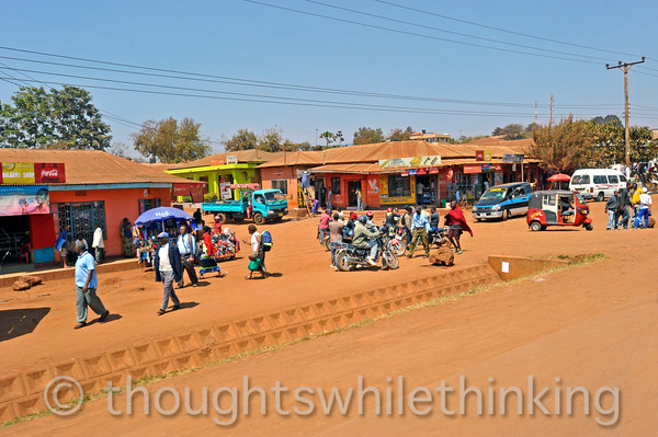 On our way to Ngorongoro Crater, shops and people gathering at the local strip mall on a mid-morning Thursday.
