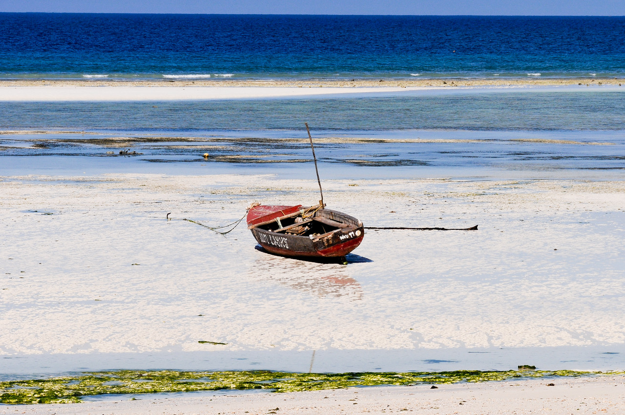 Boat on the sand during low-tide, Tanzania.