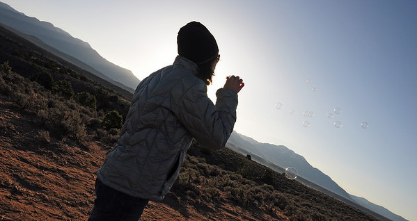 Jeannette blows some bubbles while our balloons are being readied for a ride over and into the Rio Grande Gorge. It was about 20 degrees that morning.