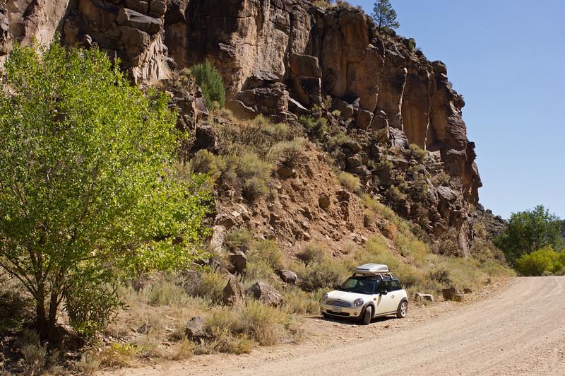 MINI Cooper on the road to the John Dunn Bridge over the Rio Grande River, northwest of Taos, New Mexico.