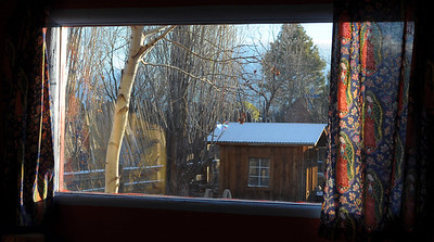 "Our view from our bedroom. Notice the Madonna pattern on the curtains. This is a common theme in Taos since the native Americans worship the Madonna the most since she was more tied to the ""mother"" earth."