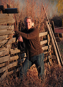 Jim relaxing by some fencing at sunset.
