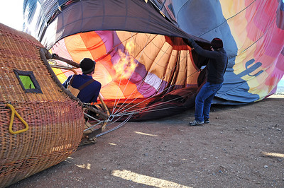 Jim helps out Captain Kris to keep the flap open as he pumps propane heat into the balloon to help it rise.